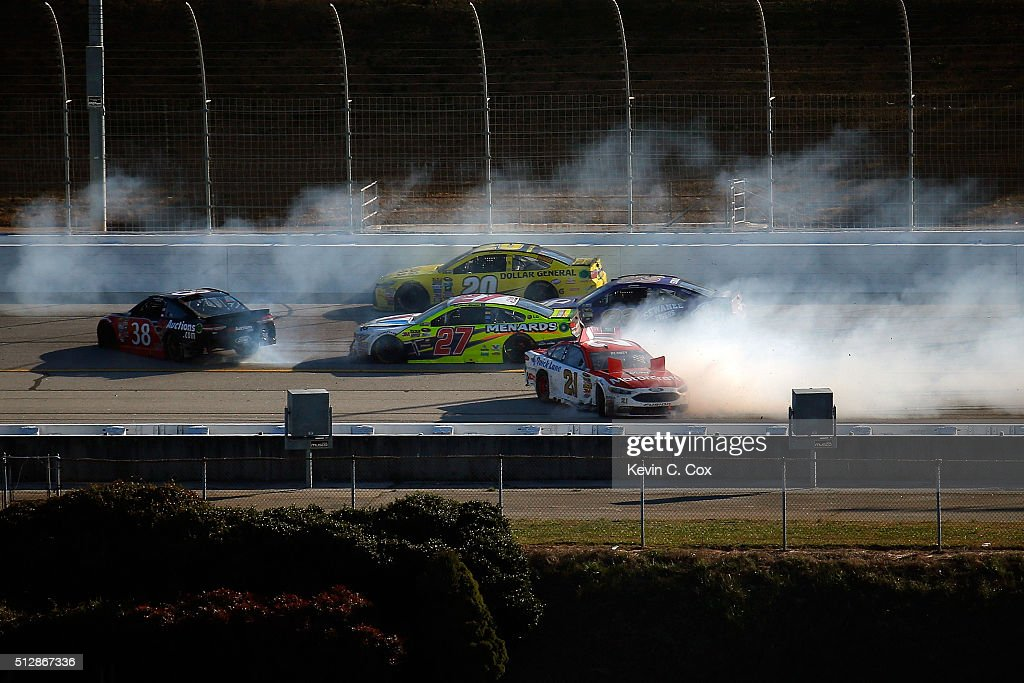 Ryan Blaney, driver of the #21 Motorcraft/Quick Lane Tire & Auto Center Ford, and Landon Cassill, driver of the #38 FR8 Auctions Ford, are involved in an on-track incident during the NASCAR Sprint Cup Series Folds of Honor QuikTrip 500 at Atlanta Motor Speedway on February 28, 2016 in Hampton, Georgia.