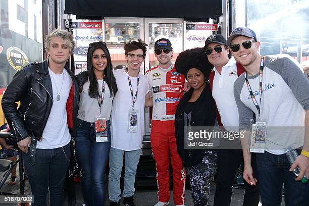 Ryan Blaney driver of the Motorcraft/Quick Lane Tire Auto Center Ford takes a photo with American Idol contestants MacKenzie Bourg La'Porsha Renae...
