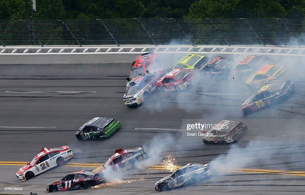 <a gi-track='captionPersonalityLinkClicked' href=/galleries/search?phrase=Ryan+Blaney&family=editorial&specificpeople=8626930 ng-click='$event.stopPropagation()'>Ryan Blaney</a>, driver of the #21 Motorcraft/Quick Lane Tire & Auto Center Ford, <a gi-track='captionPersonalityLinkClicked' href=/galleries/search?phrase=Denny+Hamlin&family=editorial&specificpeople=504674 ng-click='$event.stopPropagation()'>Denny Hamlin</a>, driver of the #11 FedEx Express Toyota, Ricky Stenhouse Jr, driver of the #17 Fifth Third Bank Ford, <a gi-track='captionPersonalityLinkClicked' href=/galleries/search?phrase=Jamie+McMurray&family=editorial&specificpeople=198964 ng-click='$event.stopPropagation()'>Jamie McMurray</a>, driver of the #1 McDonald's Chevrolet, and others are involved in an incident during the NASCAR Sprint Cup Series GEICO 500 at Talladega Superspeedway on May 1, 2016 in Talladega, Alabama.