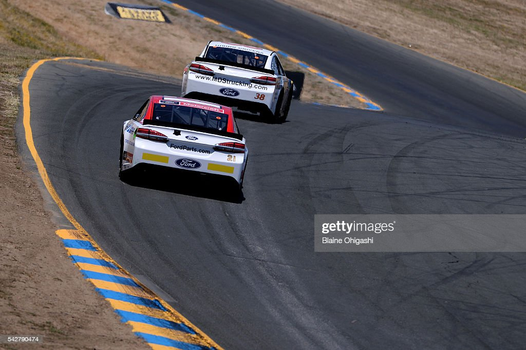 <a gi-track='captionPersonalityLinkClicked' href=/galleries/search?phrase=Ryan+Blaney&family=editorial&specificpeople=8626930 ng-click='$event.stopPropagation()'>Ryan Blaney</a>, driver of the #21 Motorcraft/Quick Lane Tire & Auto Center Ford, and <a gi-track='captionPersonalityLinkClicked' href=/galleries/search?phrase=Landon+Cassill&family=editorial&specificpeople=4421398 ng-click='$event.stopPropagation()'>Landon Cassill</a>, driver of the #38 MDS Transport Ford, practice for the NASCAR Sprint Cup Series Toyota/Save Mart 350 at Sonoma Raceway on June 24, 2016 in Sonoma, California.