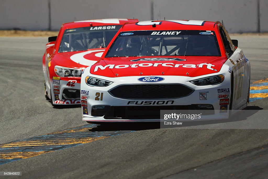 <a gi-track='captionPersonalityLinkClicked' href=/galleries/search?phrase=Ryan+Blaney&family=editorial&specificpeople=8626930 ng-click='$event.stopPropagation()'>Ryan Blaney</a>, driver of the #21 Motorcraft/Quick Lane Tire & Auto Center Ford, leads <a gi-track='captionPersonalityLinkClicked' href=/galleries/search?phrase=Kyle+Larson+-+Race+Car+Driver&family=editorial&specificpeople=2115989 ng-click='$event.stopPropagation()'>Kyle Larson</a>, driver of the #42 Target Chevrolet, during practice for the NASCAR Sprint Cup Series Toyota/Save Mart 350 at Sonoma Raceway on June 24, 2016 in Sonoma, California.