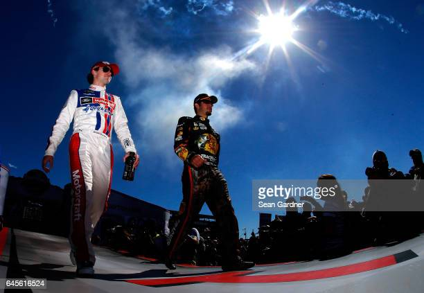 Ryan Blaney driver of the Motorcraft/Quick Lane Tire Auto Center Ford and Martin Truex Jr driver of the Bass Pro Shops/TRACKER BOATS Toyota are...