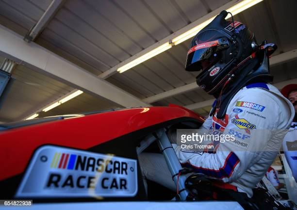 Ryan Blaney driver of the Motorcraft/Quick Lane Tire Auto Center Ford gets into his car during practice for the Monster Energy NASCAR Cup Series...