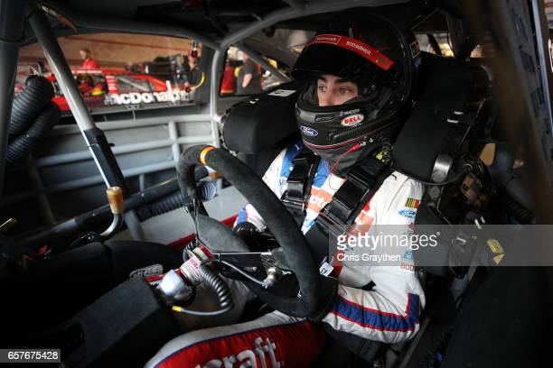 Ryan Blaney driver of the Motorcraft/Quick Lane Tire Auto Center Ford sits in his car during practice for the Monster Energy NASCAR Cup Series Auto...