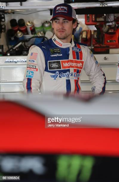 Ryan Blaney driver of the Motorcraft/Quick Lane Tire Auto Center Ford looks on from the garage during practice for the Monster Energy NASCAR Cup...
