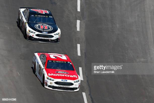 Ryan Blaney driver of the Motorcraft/Quick Lane Tire Auto Center Ford leads Kevin Harvick driver of the Jimmy John's Ford during the Monster Energy...