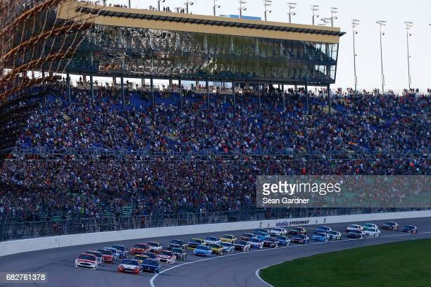 Ryan Blaney driver of the Motorcraft/Quick Lane Tire Auto Center Ford and Joey Logano driver of the AAA Insurance Ford lead the field to green during...