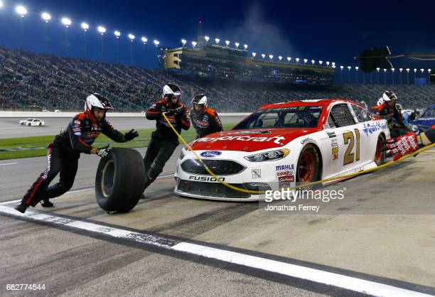 Ryan Blaney driver of the Motorcraft/Quick Lane Tire Auto Center Ford pits during the Monster Energy NASCAR Cup Series Go Bowling 400 at Kansas...