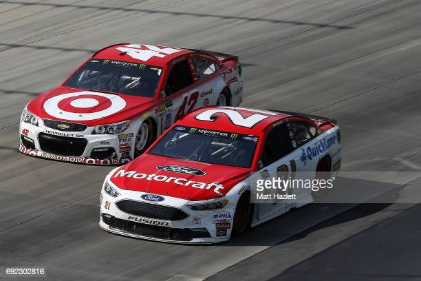 Ryan Blaney driver of the Motorcraft/Quick Lane Tire Auto Center Ford races Kyle Larson driver of the Target Chevrolet during the Monster Energy...