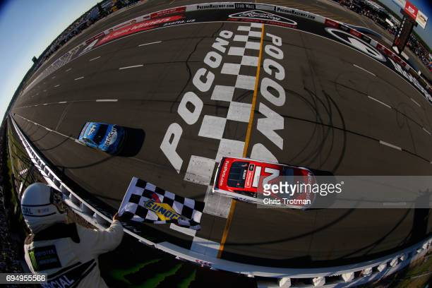 Ryan Blaney driver of the Motorcraft/Quick Lane Tire Auto Center Ford takes the checkered flag to win the Monster Energy NASCAR Cup Series Axalta...