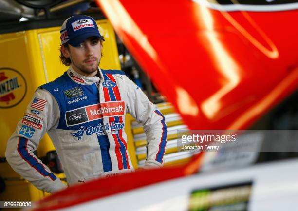 Ryan Blaney driver of the Motorcraft/Quick Lane Tire Auto Center Ford stands in the garage area during practice for the Monster Energy NASCAR Cup...