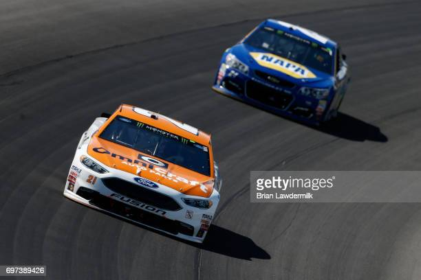 Ryan Blaney driver of the Omnicraft Auto Parts Ford leads Chase Elliott driver of the NAPA Chevrolet during the Monster Energy NASCAR Cup Series...