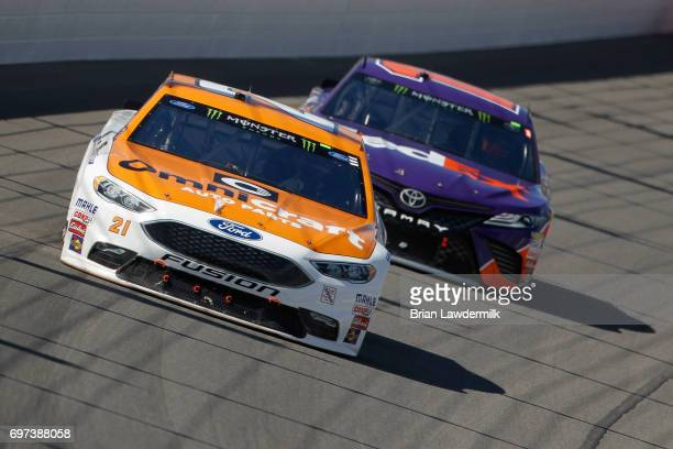 Ryan Blaney driver of the Omnicraft Auto Parts Ford leads Denny Hamlin driver of the FedEx Office Toyota during the Monster Energy NASCAR Cup Series...