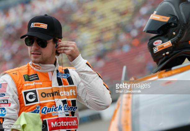 Ryan Blaney driver of the Omnicraft Auto Parts Ford stands on the grid during qualifying for the Monster Energy NASCAR Cup Series FireKeepers Casino...