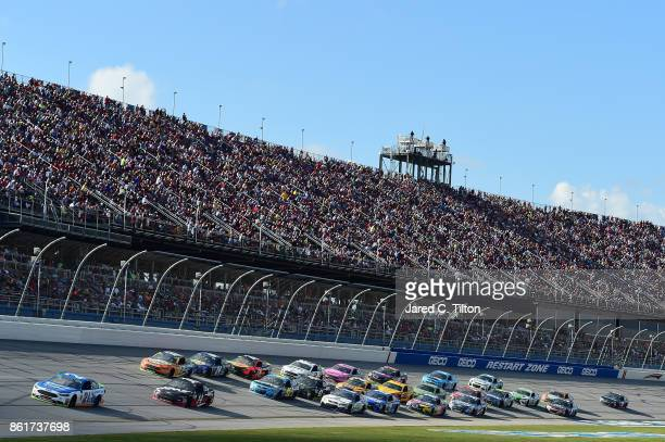 Ryan Blaney driver of the Quick Lane Tire Auto Center Ford leads a pack of cars during the Monster Energy NASCAR Cup Series Alabama 500 at Talladega...