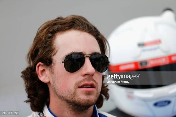 Ryan Blaney driver of the Quick Lane Tire Auto Center Ford stands on the grid during qualifying for the Monster Energy NASCAR Cup Series Alabama 500...