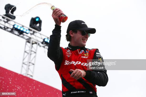 Ryan Blaney driver of the SnapOn Ford celebrates in victory lane after winning the NASCAR Xfinity Series Hisense 4K TV 300 at Charlotte Motor...