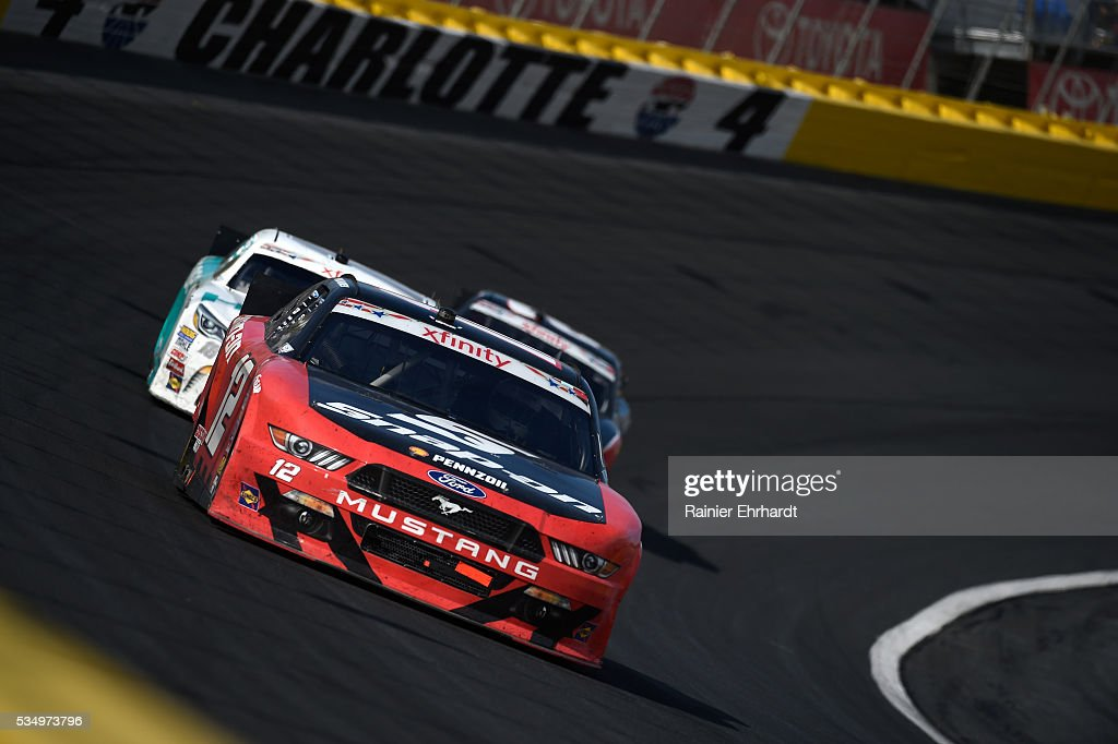 <a gi-track='captionPersonalityLinkClicked' href=/galleries/search?phrase=Ryan+Blaney&family=editorial&specificpeople=8626930 ng-click='$event.stopPropagation()'>Ryan Blaney</a>, driver of the #12 Snap-on Ford, leads a pack of cars during the NASCAR XFINITY Series Hisense 300 at Charlotte Motor Speedway on May 28, 2016 in Charlotte, North Carolina.
