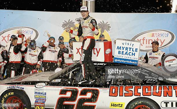 Ryan Blaney the driver of the Discount Tire Ford celebrates in Victory Lane after winning the the NASCAR Xfinity Series VisitMyrtleBeachcom 300 at...