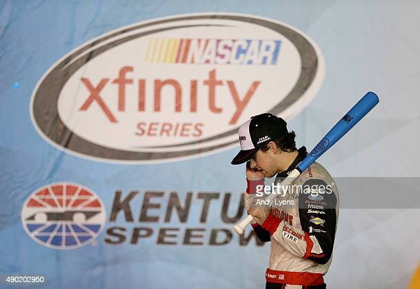 Ryan Blaney the driver of the Discount Tire Ford talks on a phone in Victory Lane after winning the the NASCAR Xfinity Series VisitMyrtleBeachcom 300...
