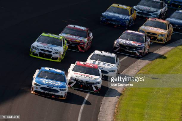 Ryan Blaney Wood Brothers Ford Fusion and Erik Jones Furniture Row Racing Toyota Camry battle for the lead during the NASCAR Monster Energy Cup...