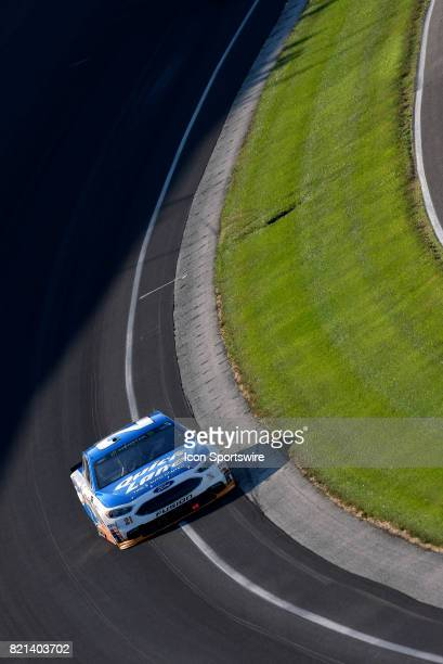 Ryan Blaney Wood Brothers Ford Fusion drives through trun one during the NASCAR Monster Energy Cup Series Brantley Gilbert Big Machine Brickyard 400...