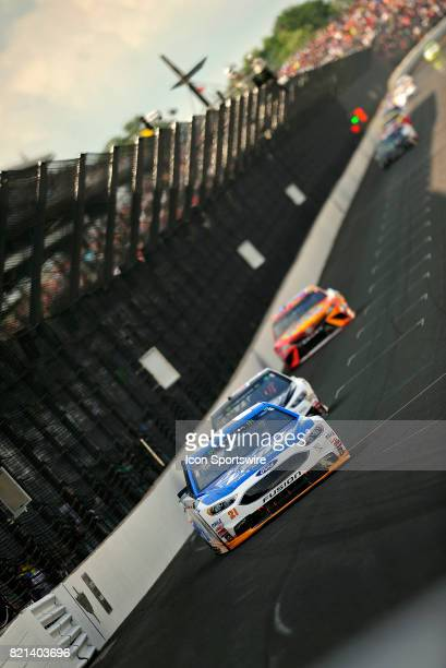Ryan Blaney Wood Brothers Ford Fusion leads a group of cars down the front stretch during the NASCAR Monster Energy Cup Series Brantley Gilbert Big...