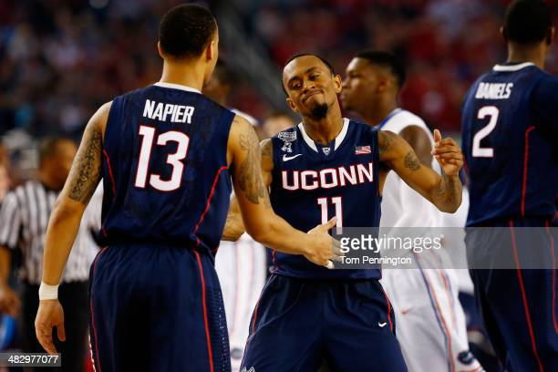 Ryan Boatright and Shabazz Napier of the Connecticut Huskies celebrate against the Florida Gators during the NCAA Men's Final Four Semifinal at ATT...