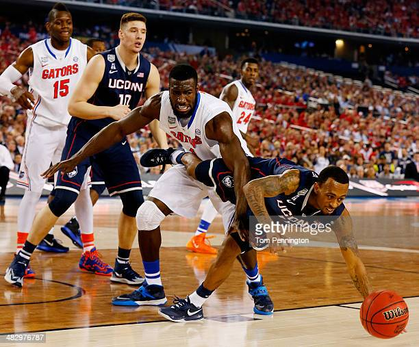 Ryan Boatright of the Connecticut Huskies and Patric Young of the Florida Gators battle for a loose ball during the NCAA Men's Final Four Semifinal...