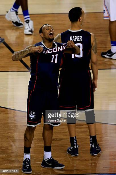Ryan Boatright of the Connecticut Huskies celebrates after defeating the Florida Gators 6353 in the NCAA Men's Final Four Semifinal at ATT Stadium on...