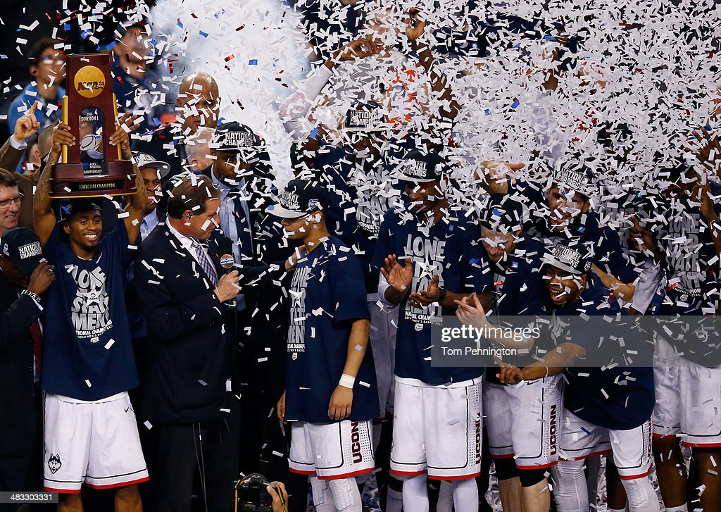 Ryan Boatright of the Connecticut Huskies celebrates with the trophy after defeating the Kentucky Wildcats 6054 in the NCAA Men's Final Four...