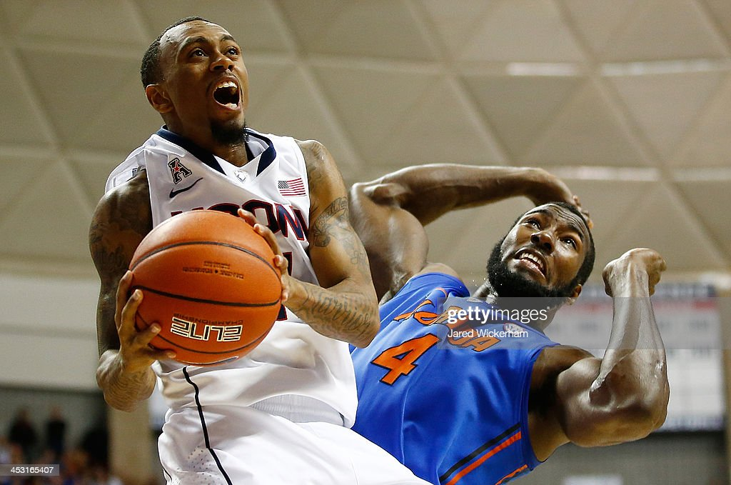 Ryan Boatright #11 of the Connecticut Huskies drives to the basket in front of Patric Young #4 of the Florida Gators in the second half during the game at Harry A. Gampel Pavilion on December 2, 2013 in Storrs, Connecticut.