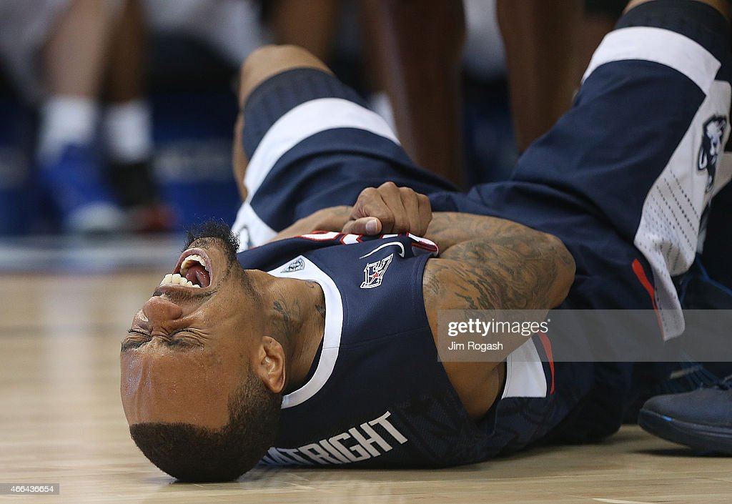 <a gi-track='captionPersonalityLinkClicked' href=/galleries/search?phrase=Ryan+Boatright&family=editorial&specificpeople=8698049 ng-click='$event.stopPropagation()'>Ryan Boatright</a> #11 of the Connecticut Huskies grimaces in pain from an injury in the second half against the Southern Methodist Mustangs in the final game of the American 2015 Championships at the XL Center on March 15, 2015 in Hartford, Connecticut.