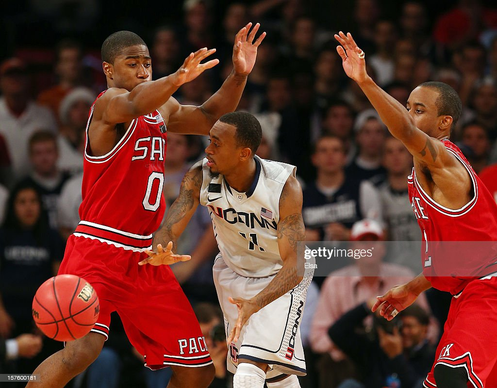 Ryan Boatright #11 of the Connecticut Huskies is pressured by Rodney Purvis #0 anc Lorenzo Brown #2 of the North Carolina State Wolfpack during the Jimmy V Classic on December 4, 2012 at Madison Square Garden in New York City. The North Carolina State Wolfpack defeated the Connecticut Huskies 69-65.
