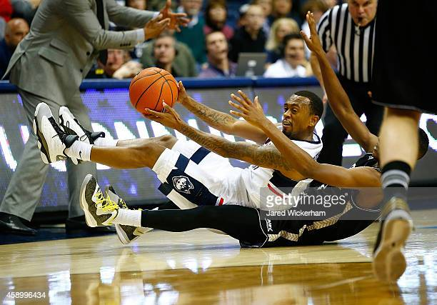 Ryan Boatright of the Connecticut Huskies picks up a loose ball on his back against the Byrant Bulldogs in the second half during the game at Harry A...