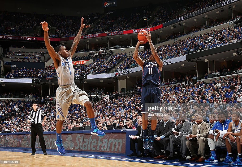 Ryan Boatright #11 of the Connecticut Huskies shoots a jumpshot against Joe Jackson #1 of the Memphis Tigers on January 16, 2014 at FedExForum in Memphis, Tennessee. Connecticut beat Memphis 83-73.