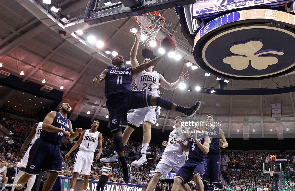 Ryan Boatright #11 of the Connecticut Huskies shoots under the basket as Pat Connaughton #24 of the Notre Dame Fighting Irish defends at Purcel Pavilion on January 12, 2012 in South Bend, Indiana.
