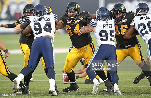 Ryan Bomben of the Hamilton TigerCats plays against the Toronto Argonauts during a CFL football game at Tim Hortons Field on August 3 2015 in...