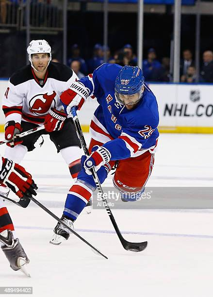 Ryan Borque of the New York Rangers shoots against the New Jersey Devils during their Pre Season game at Madison Square Garden on September 21 2015...