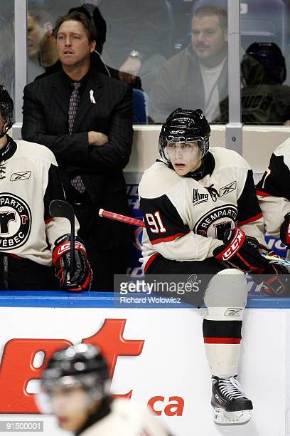 Ryan Bourque of the Quebec Remparts watches play from the bench during the game against the Baie Comeau Drakkar at Colisee Pepsi on October 2 2009 in...