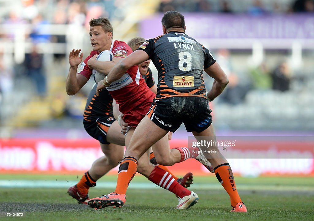 Ryan Boyle (L) and Andy Lynch of Castleford Tigers tackle Jacob Miller of Wakefield Trinity Wildcats during the Super League match between Castleford Tigers and Wakefield Trinity Wildcats at St James' Park on May 31, 2015 in Newcastle upon Tyne, England.
