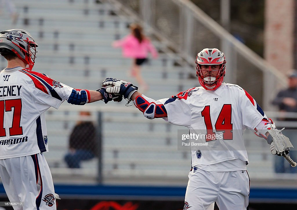 Ryan Boyle #14 of the Boston Cannons celebrates a goal during a Major League Lacrosse game against the New York Lizards at James M. Shuart Stadium on April 28, 2013 in Hempstead, New York.