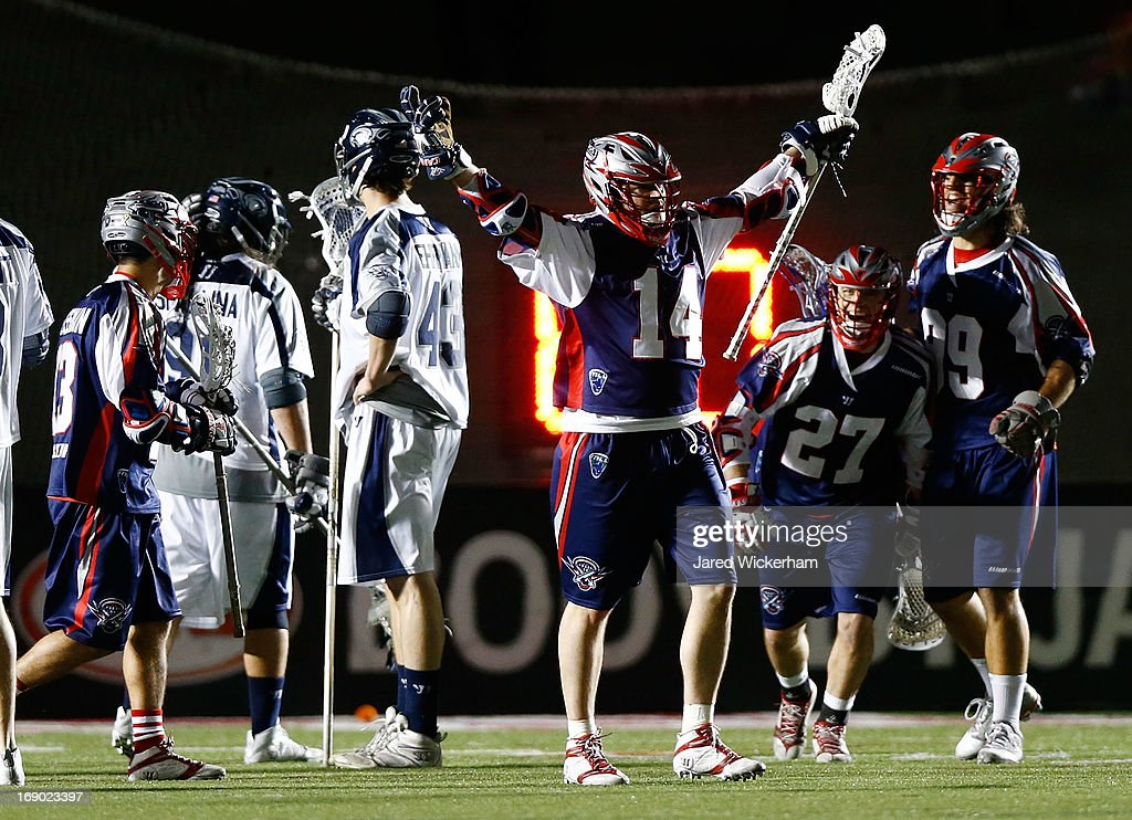 Ryan Boyle #14 of the Boston Cannons celebrates after scoring the game-winning goal in overtime against the Chesapeake Bayhawks during the game on May 18, 2013 at Harvard Stadium in Boston, Massachusetts.