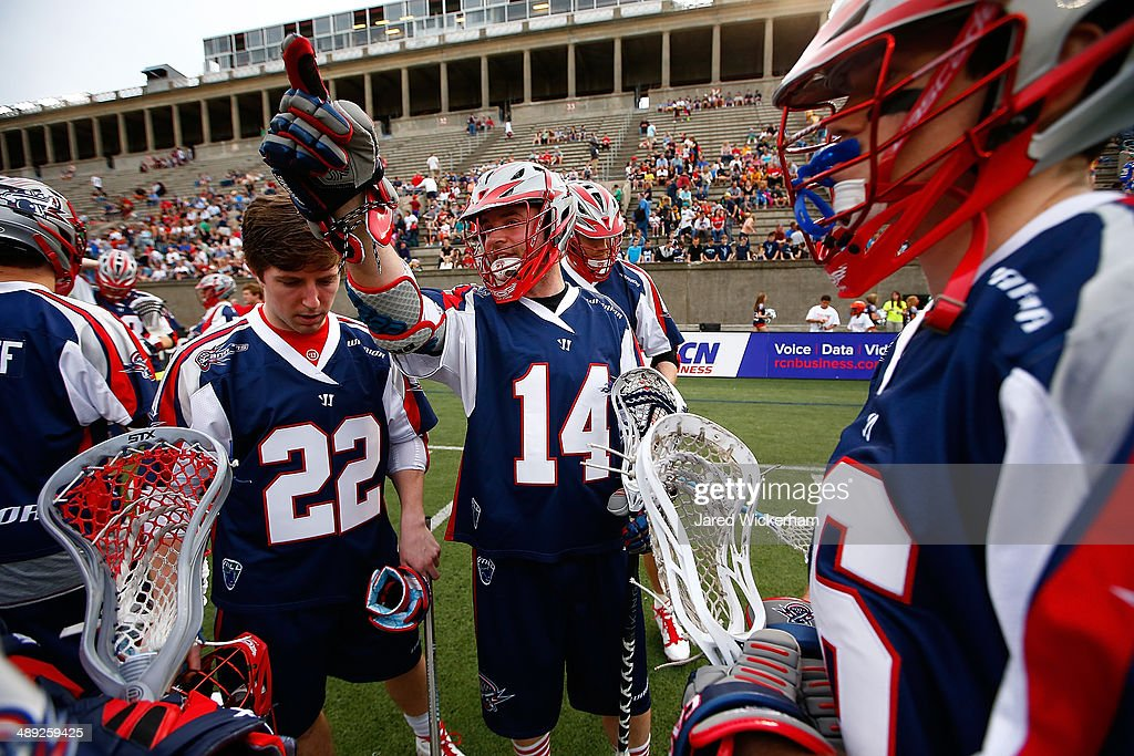 Ryan Boyle #14 of the Boston Cannons directs his teammates in a huddle prior to the game against the Denver Outlaws at Harvard Stadium on May 10, 2014 in Boston, Massachusetts.