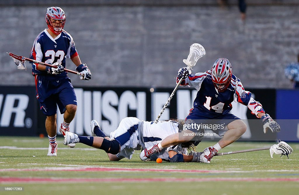 Ryan Boyle #14 of the Boston Cannons lands on a member of the Chesapeake Baykawks while going for the ball in the first half during the game on May 18, 2013 at Harvard Stadium in Boston, Massachusetts.