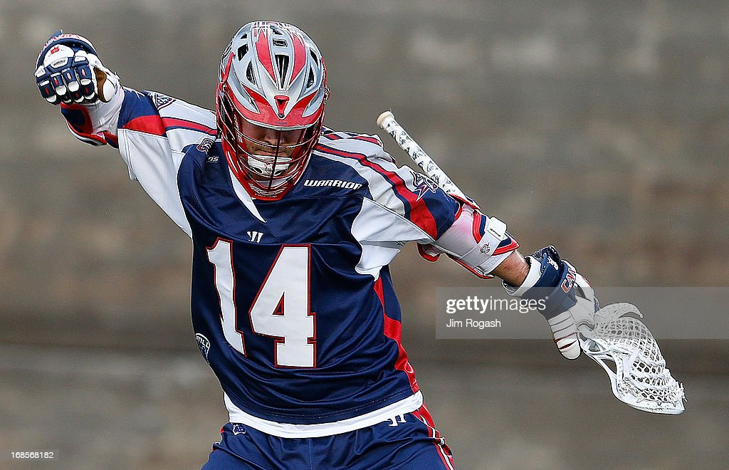 Ryan Boyle #14 of the Boston Cannons reacts to a goal by his teammate in the first quarter against the Denver Outlaws at Harvard Stadium on May 11, 2013 in Boston, Massachusetts. He earned an assist on a goal.