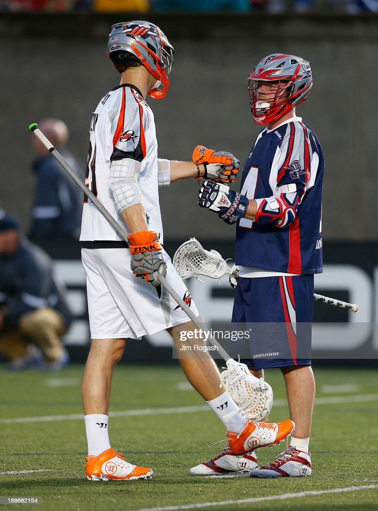 Ryan Boyle #14 of the Boston Cannons shakes hands with a member of the Denver Outlaws at Harvard Stadium on May 11, 2013 in Boston, Massachusetts.