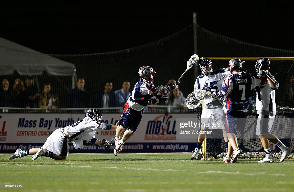 Ryan Boyle #14 of the Boston Cannons shoots and scores the game-winning goal in overtime against the Chesapeake Bayhawks during the game on May 18, 2013 at Harvard Stadium in Boston, Massachusetts.