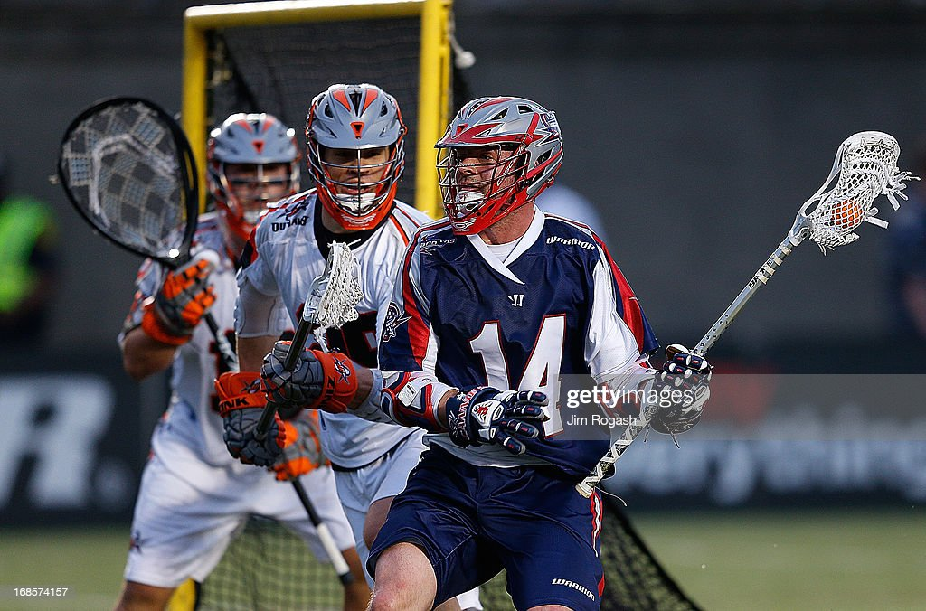 Ryan Boyle #14 of the Boston Cannons works his way toward the net against the Denver Outlaws at Harvard Stadium on May 11, 2013 in Boston, Massachusetts. He earned an assist on a goal.
