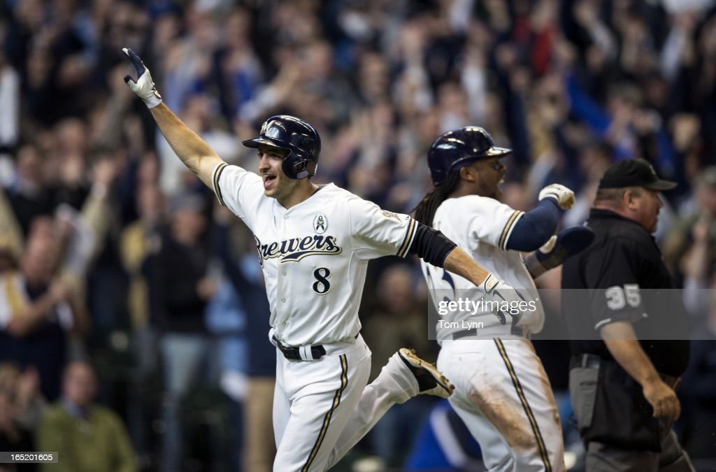 Ryan Braun #8 and <a gi-track='captionPersonalityLinkClicked' href=/galleries/search?phrase=Rickie+Weeks&family=editorial&specificpeople=550245 ng-click='$event.stopPropagation()'>Rickie Weeks</a> #23 of the Milwaukee Brewers score in the eighth inning against the Colorado Rockies on opening day at Miller Park on April 1, 2013 in Milwaukee, Wisconsin. The Milwaukee Brewers defeated the Colorado Rockier 5-4.